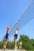 Three Men Playing Beach Volleyball - Fat Man Versus Balding One