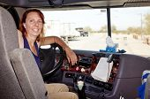 stock photo of 18-wheeler  - Woman driver at the wheel of her commercial 