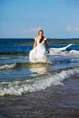 Bride Running In Waves