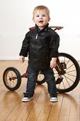 Toddler Boy In Leather Jacket
