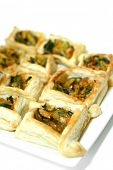 Close up:Vegetable stuff in filo pastry with sprinkle of cheese on white background , isolated