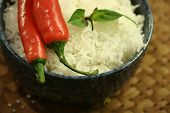 Thai Asian cuisine: Asian diet comprising of red chillies and fluffy jasmine rice  in a basket tray poster