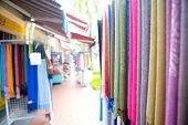 A shop selling colorful souvenirs, scarves and pashminas at Jalan Sultan, Singapore.
