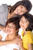 Two beautiful girls of mix parentage with their happy Chinese mother.