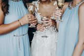 Luxury Life Concept. Gorgeous Bride And Bridesmaids Toasting With Champagne And Having Fun In Hotel poster