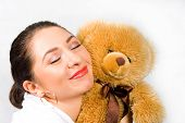 Young Beautiful Woman With Toy Bear poster