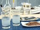 image of ouzo  - Ouzo and misc seafood near the beach