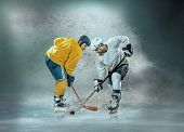 Caucassian ice hockey Players in dynamic action in a professional sport game play on the laptop in h poster
