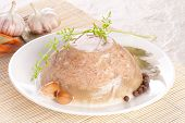 Meat In Aspic On White Plate Closeup