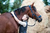 Portrait Of Young Teenage Girl Equestrian Lovely Hugging Her Favorite Brown Horse Neck. Colored Outd poster