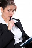 Portrait of woman in a suit with pen and notepad