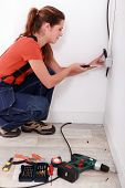 Electrician installing an electrical outlet