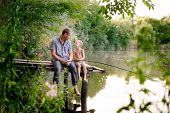 Dad And Son Fishing Outdoors, On Lake. Father And His Son Fishing Together From Wooden Jetty, Summer poster
