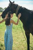 Its About Building A Trusting Relationship. Adorable Horse Owner Touching Pet. Pretty Girl At Horse  poster
