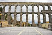 The well-known antique aqueduct and ancient Segovia in cloudy May day