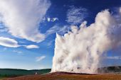 The well-known geyser in Yellowstone national park - Old Faithful. Eruption comes to an end