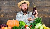 Man With Beard Wooden Background. Farmer With Organic Vegetables. Excellent Quality Harvest. Grow Or poster
