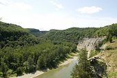 wooded valley, exposed rock and Genesee River