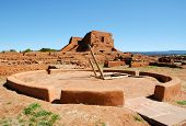 Pecos Pueblo Mission Church with a native american indian kiva and ladder