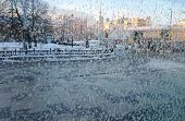 Frost Patterns On A Glass. City View Through A Frosted Window. Concept Of Extremely Cold Weather Con poster