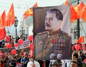 MOSCOW - MAY 1: Communist party supporters take part in a rally marking the May Day, a portrait of S