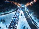 Aerial View Of Road In The City At Night In Winter. Top View Of Traffic In Road With Illumination. L poster