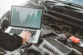 Professional Technician Hands Of Checking Car Engine Repair Service Using Laptop On Car poster