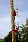 TULUM, MEXICO - AUGUST 10: Dance of Los Voladores the Totonac, performing ancient ritual on August 1