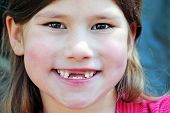 stock photo of toothless smile  - toothless little girl gives a big smile - JPG