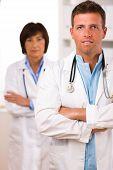 pic of youg  - Team of medical doctors youg male and senior female - JPG