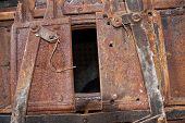 The Door Of The Old Rusty Locomotive Boiler