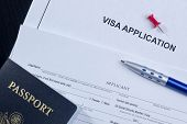 stock photo of citizenship  - Directly above photograph of an application for a visa - JPG