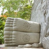 stock photo of swastika  - Feet of a sleeping buddha decorated with a swastika landmark on Nha Trang Vietnam - JPG