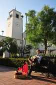 Busker And Clock Tower