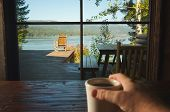 Cup Of Coffee And View Of Lake