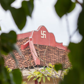stock photo of swastika  - Swastika symbol on top of a temple in Vietnam  - JPG