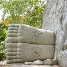 pic of swastika  - Feet of a sleeping buddha decorated with a swastika landmark on Nha Trang Vietnam - JPG