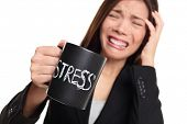 Stress at work concept. Business woman stressed being to busy. Businesswoman in suit holding head dr