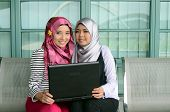 pic of muslimah  - beautiful young muslim business woman smile together - JPG