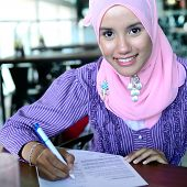 Lovely of young Asian businesswoman working