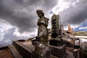 foto of cherubim  - Photo image of a cemetery with sky in the background - JPG