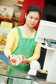 chinese shop young woman worker choosing food tea during shopping at china supermarket