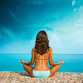 Woman Doing Yoga at the Sea