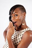 black woman with hand over mouth in surprise