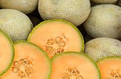 stock photo of cantaloupe  - Cantaloupe melon pieces on a weekly fruit market - JPG