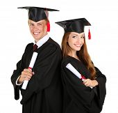 stock photo of graduation gown  - Two happy graduating students isolated on white - JPG