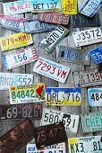 Old car license plates on the wall