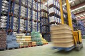 stock photo of forklift  - View of speeding forklift in warehouse - JPG