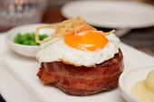 Tenderloin steak with fried egg and green pies, british dish