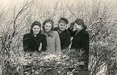 RAWICZ, POLAND, CIRCA FORTIES - vintage photo of four girls in students caps, Poland, circa forties